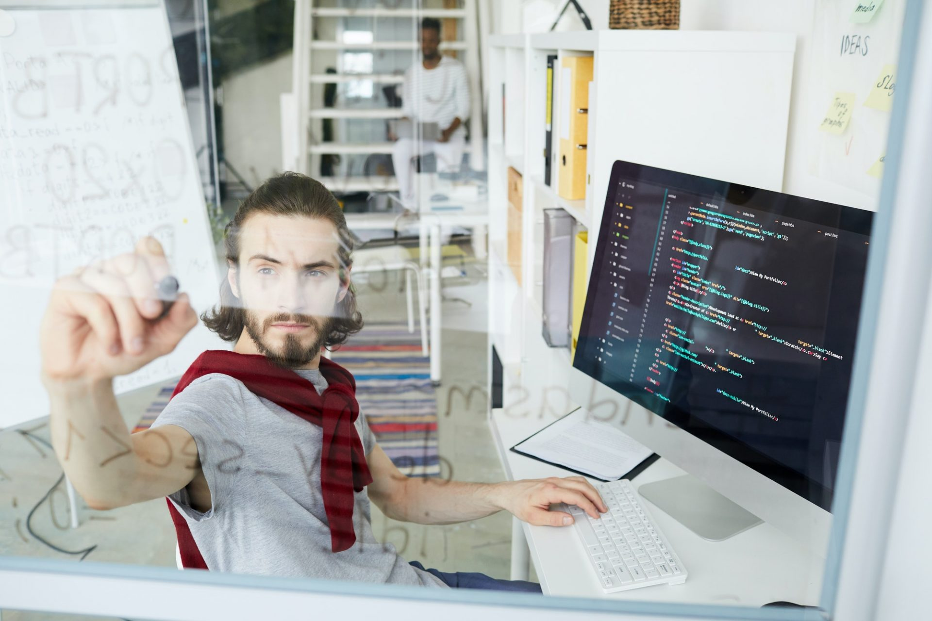 Creative hipster coder working with programming language